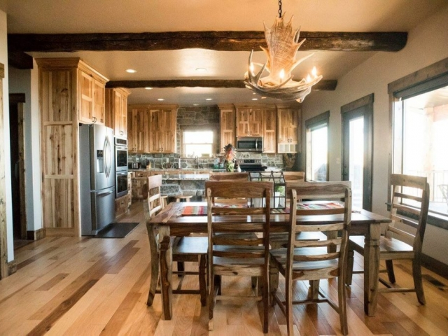 antler chandelier hanging in rustic kitchen