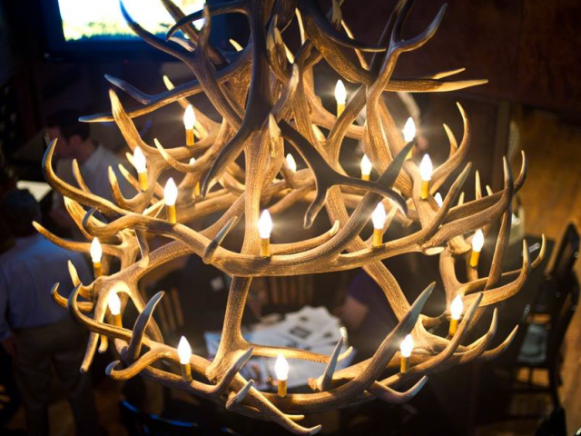 Deer Antler Chandelier In Restaurant