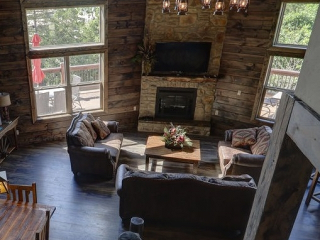 wagon wheel chandelier in cabin